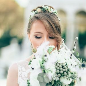 Beautiful bride with updo hairstyle with a floral hair wreath